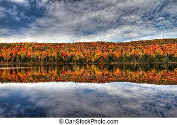 Autumn reflection - peak autumn colors in la mauricie...