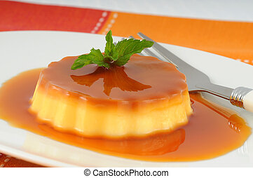 Creme Caramel - Delicious creme caramel with a sprig of...