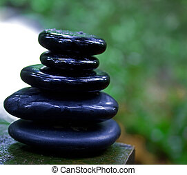 zen stones in the forest. - several black spa stones...
