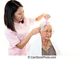 Senior woman with medical staff - Smiling Asian medical...