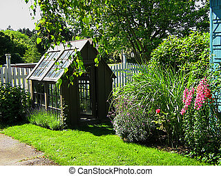 Home Landscaping - A photograph of a small greenhouse among...