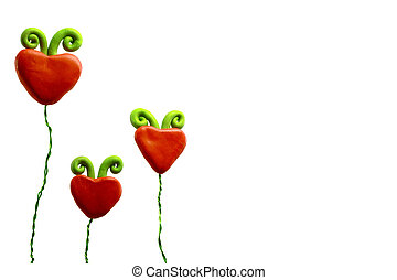 Three heart flowers - A family of three red heart flowers on...
