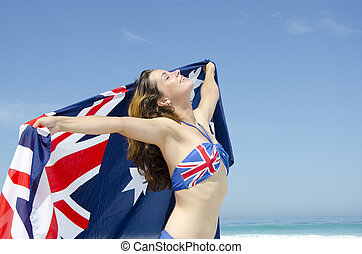 Sexy woman Australian flag at beach - Sexy happy young woman...
