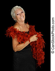 mature woman with feather boa - Happy smiling mature woman...
