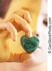 heart - A heart of a gem stone in a hand of children