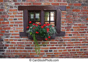Small widow of old medieval house. - Small widow of old...