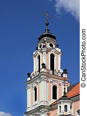 Fragment of Catholic Church in baroque style with great number architectural details and embellishments. Vilnius, Lithuania.
