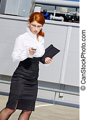 communication - bright picture of businesswoman with folder...