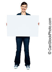 Fashionable trendy woman holding blank ad board - Full...