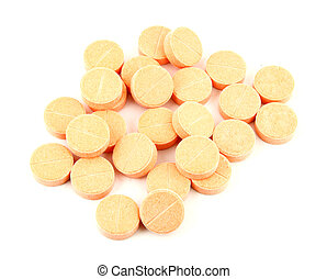 pill of vitamin C on white background