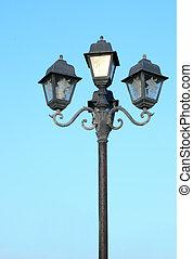 old street light against blue sky - old street light against...