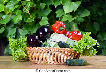 vegetables in wicker - Composition with vegetables in wicker...
