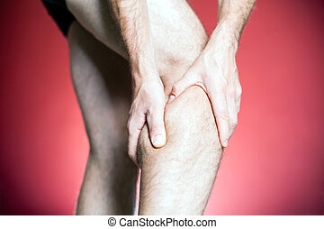 Knee Pain, man holding leg, making massage with hands...