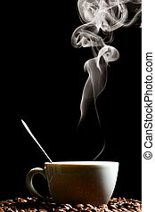 hot morning coffee - coffee beans and white hot cup of drink