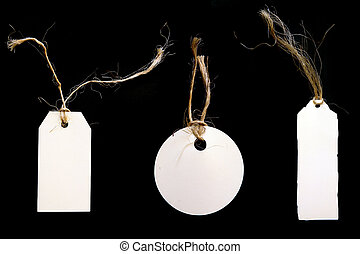 White Tags With Twine on Black Background - White Price Tags...