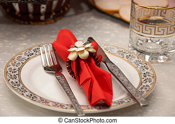 decorated plate set on table for christmass