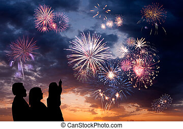 Happy family looks fireworks - The happy family looks...