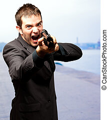 Angry Man Holding Gun, outdoor