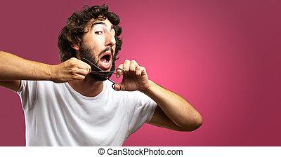 Man Cutting Beard