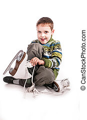 boy with skates, insulated background - boy holding skates,...