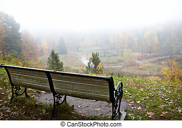 Bench at the hill. - Bench at the top of the hill. The fog...