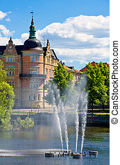 Norrkoping. Sweden - Fountain on a river. Norrkoping,...