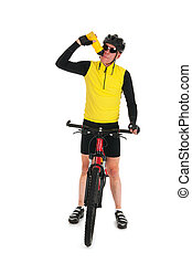 Mountain biker drinking water in studio - Active mountain...