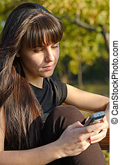Woman texting on her mobile