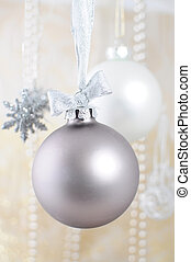 Silver christmas bauble on ribbon