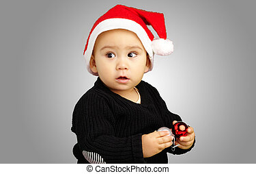 Baby Boy Wearing Santa Hat Holding Christmas Ornaments