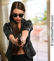 Woman Aiming With Gun, indoor