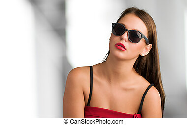 Portrait Of Young Fashioned Woman against an abstract...