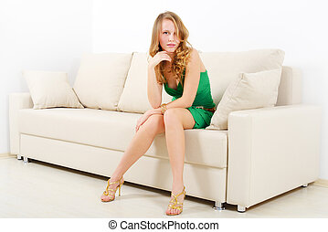 Elegant girl on sofa