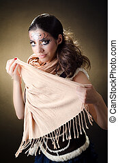 Exoticism - The model covers her face with a scharf....