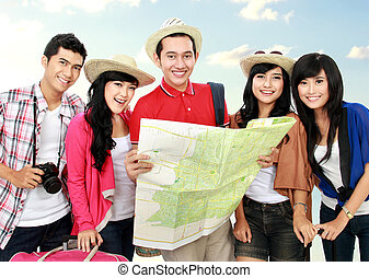 Happy young people tourists one holding the map