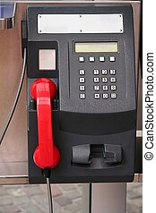 Black public phone with red receiver earmouth - concept of...