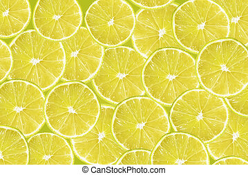 Abstract yellow background with citrus-fruit of lime slices....