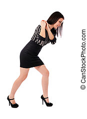 Young businesswoman pulling an imaginary rope