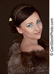 Fashion Woman in fur coat with make up. Luxury Style