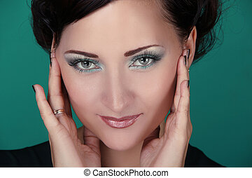Close-up portrait of woman with beautiful blue eyes, make up...