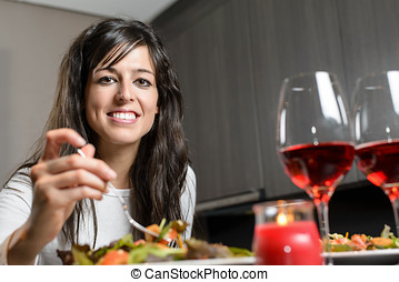 Dinner for couple - Pretty brunette woman sitting at the...