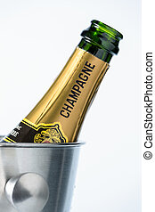 champagne in ice bucket - a bottle of champagne in an ice...