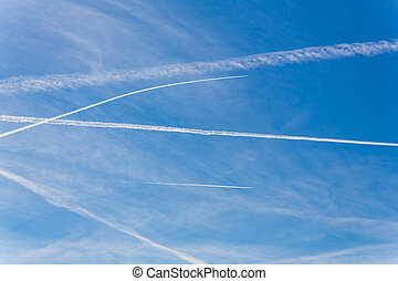contrails from aircraft - contrails of aircraft against a...