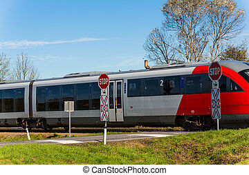 unbeschrankter crossing - a crossing of a railway without...