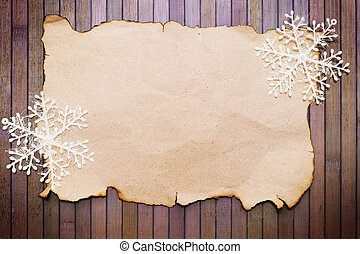 paper and decorative snowflakes - Old burnt empty paper and...