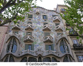 BARCELONA - APRIL 28: The facade of the house Casa Batllo on April 28, 2006 in Barcelona, Spain. Also could the house of bones, was designed by Antoni Gaudi with his famous expressionistic style.