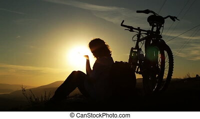 Mountain biker - sunset silhouette
