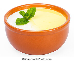 Ceramic cup milk soup with butter, embellished with mint...
