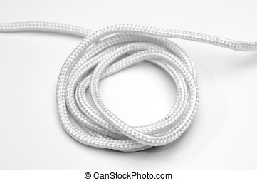 Rolled up rope on white background