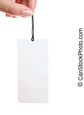 fingers and white paper tag isolated on white